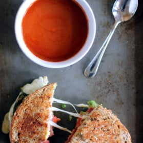 Healthy turkey bacon, avocado, and mozzarella grilled cheese with tomato soup