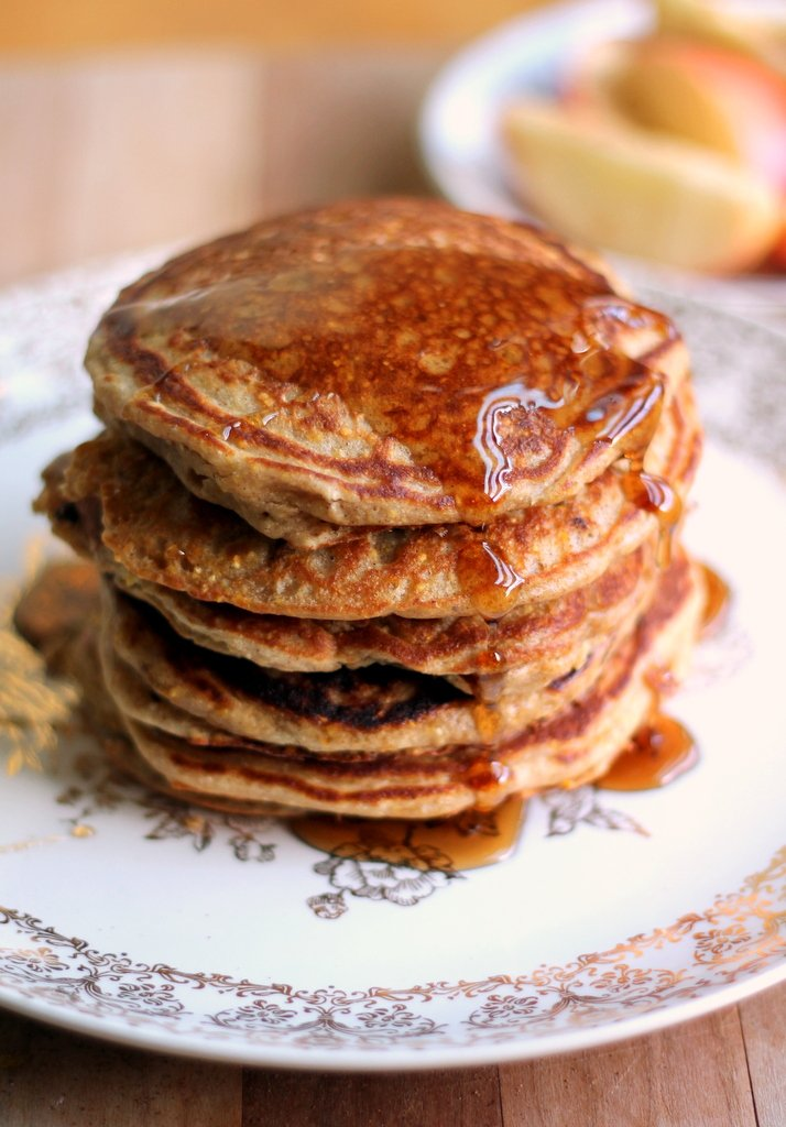 Maple sausage cornmeal pancakes in a stack with maple syrup