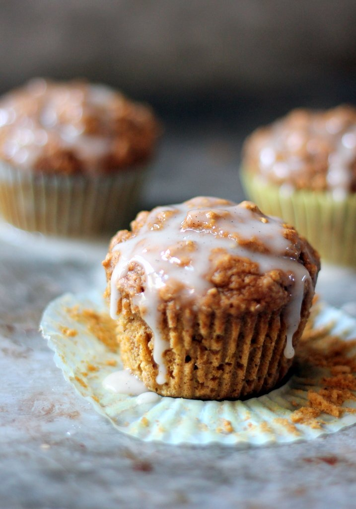 Pumpkin oatmeal muffins topped with cream cheese glaze
