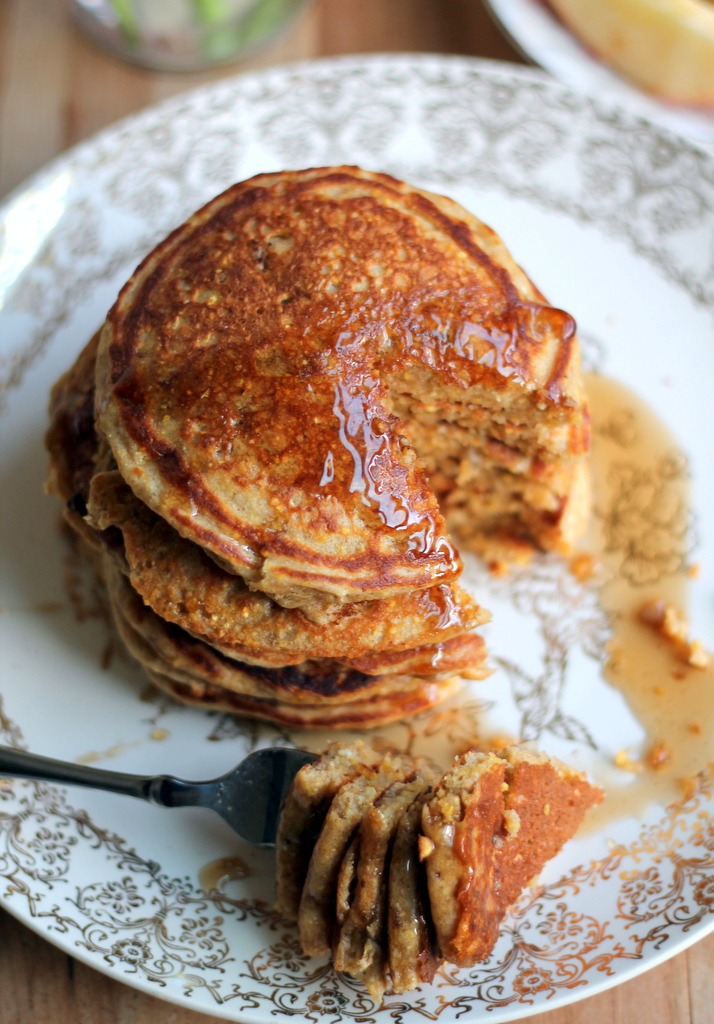 Maple sausage cornmeal pancakes in a stack on a plate