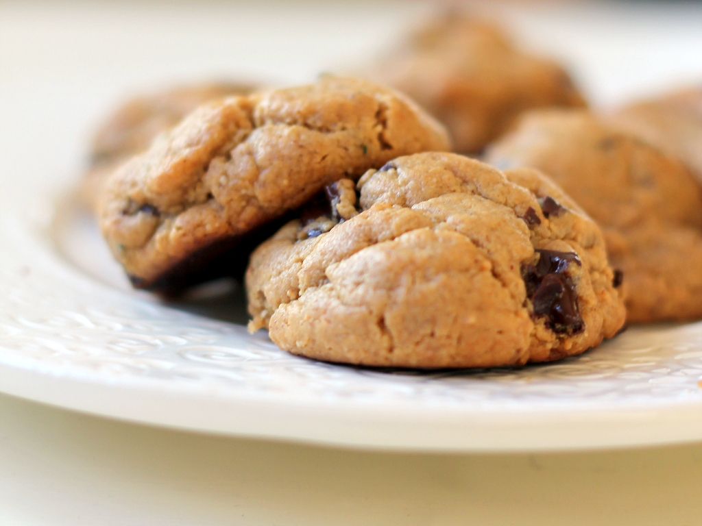 Flourless peanut butter chocolate chunk cookies on a plate