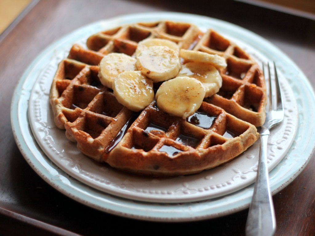 Banana chocolate chip quinoa flour waffles on a plate