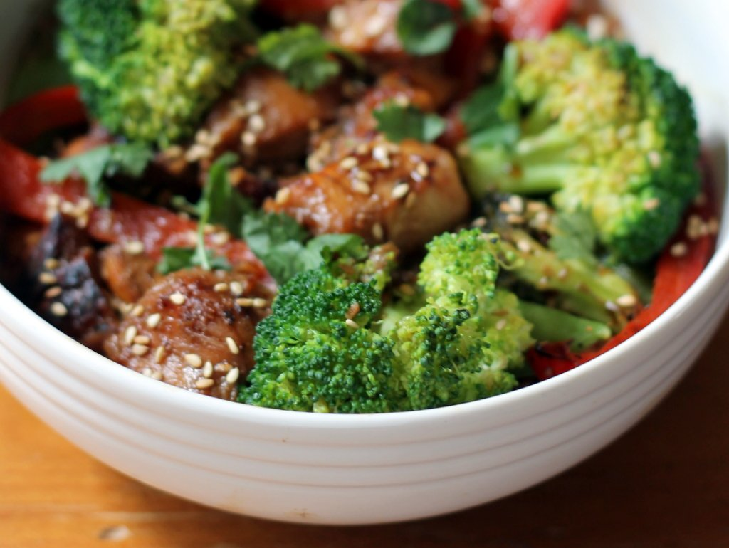 Sesame chicken stir fry in a bowl with veggies