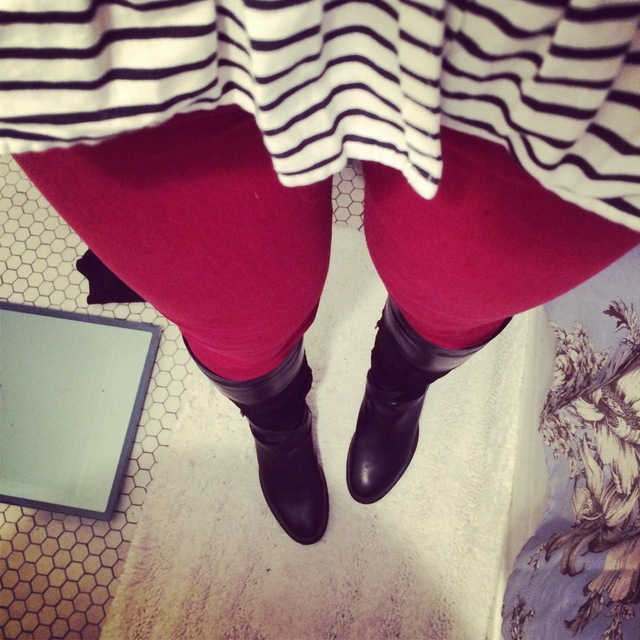 Red pants and black boots