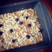 Healthy chocolate chip coconut oatmeal banana bread in a loaf pan