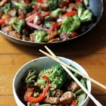 Sesame chicken stir fry in a bowl and in a pan