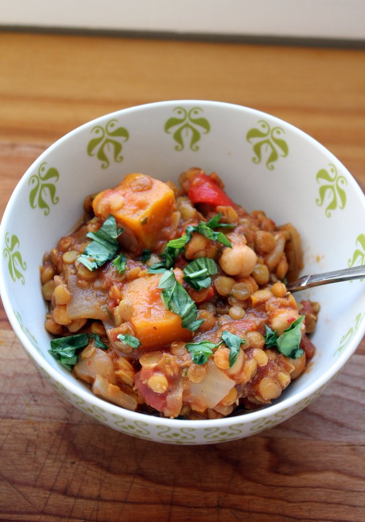 butternut squash and lentil stew in a white bowl