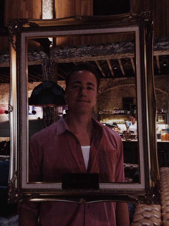 Tony holding up a frame