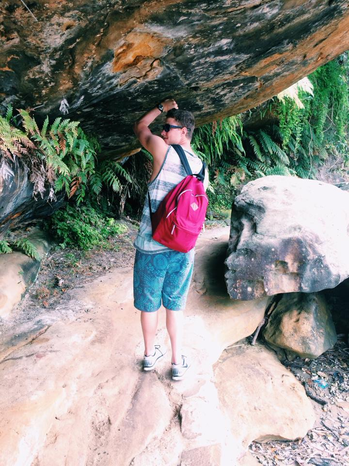 Tony scaling rocks in Australia