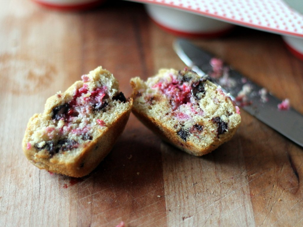 Raspberry chocolate chip cream cheese muffins cut in half