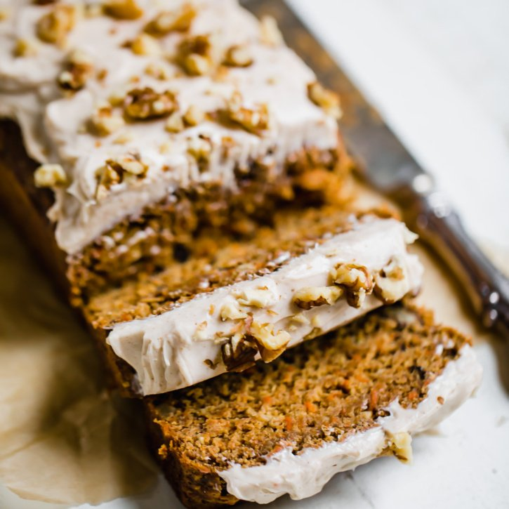 carrot cake banana bread sliced on parchment paper