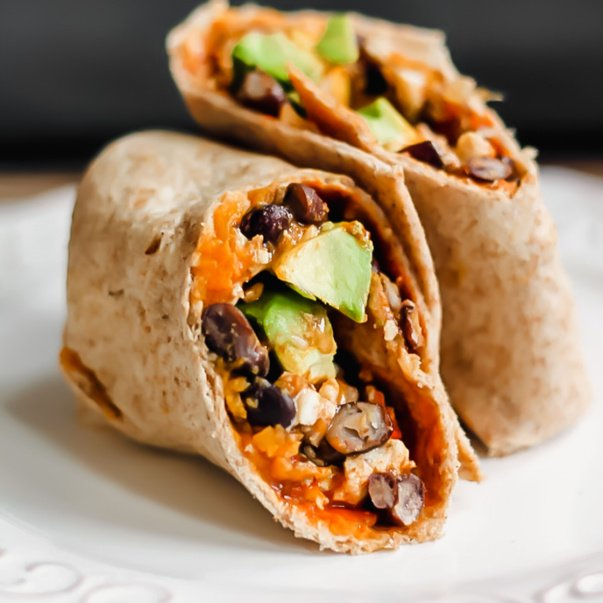 healthy breakfast burrito with avocado, sweet potato and black beans