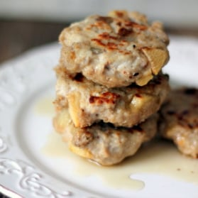 maple sausage breakfast patties in a stack on a plate