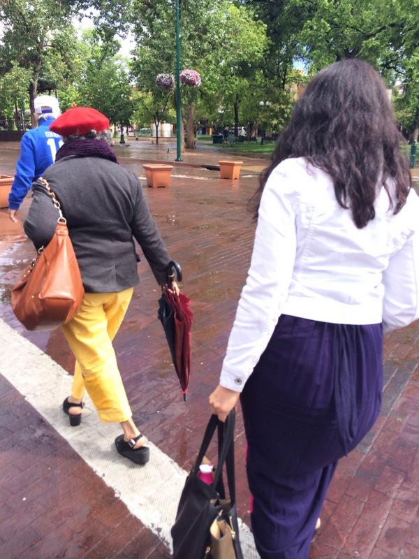 two women walking in a park