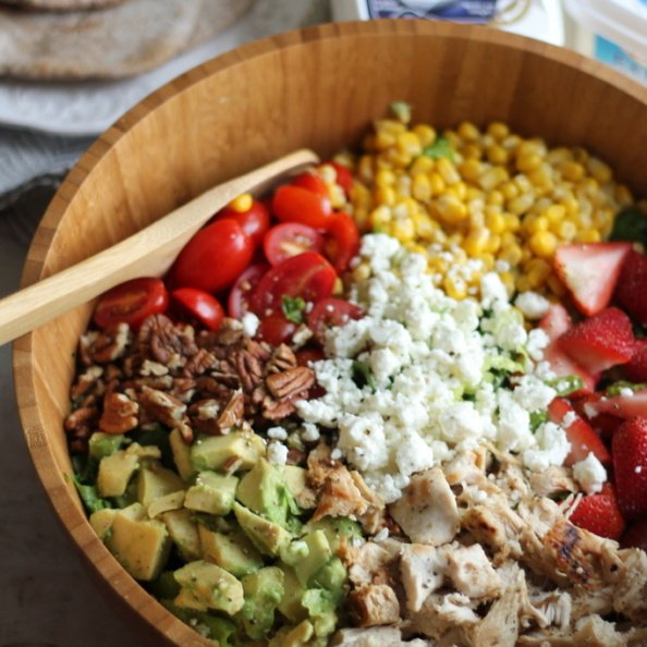 Chicken chopped salad in a wooden bowl