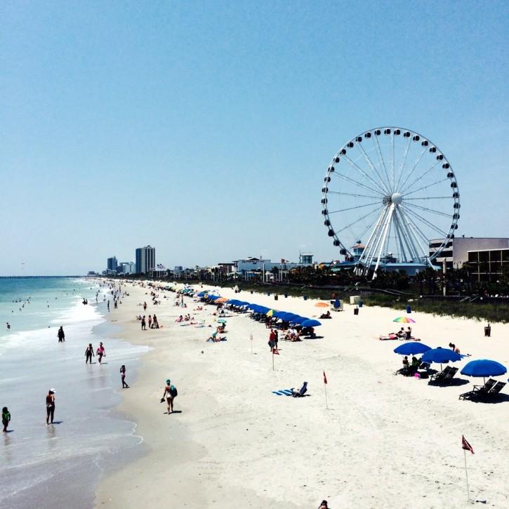 beach with a ferris wheel