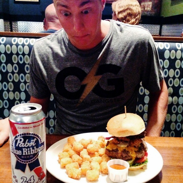 tony with a burger and a beer