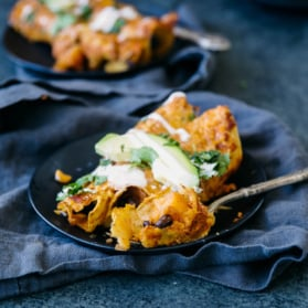 butternut squash black bean enchiladas on a plate