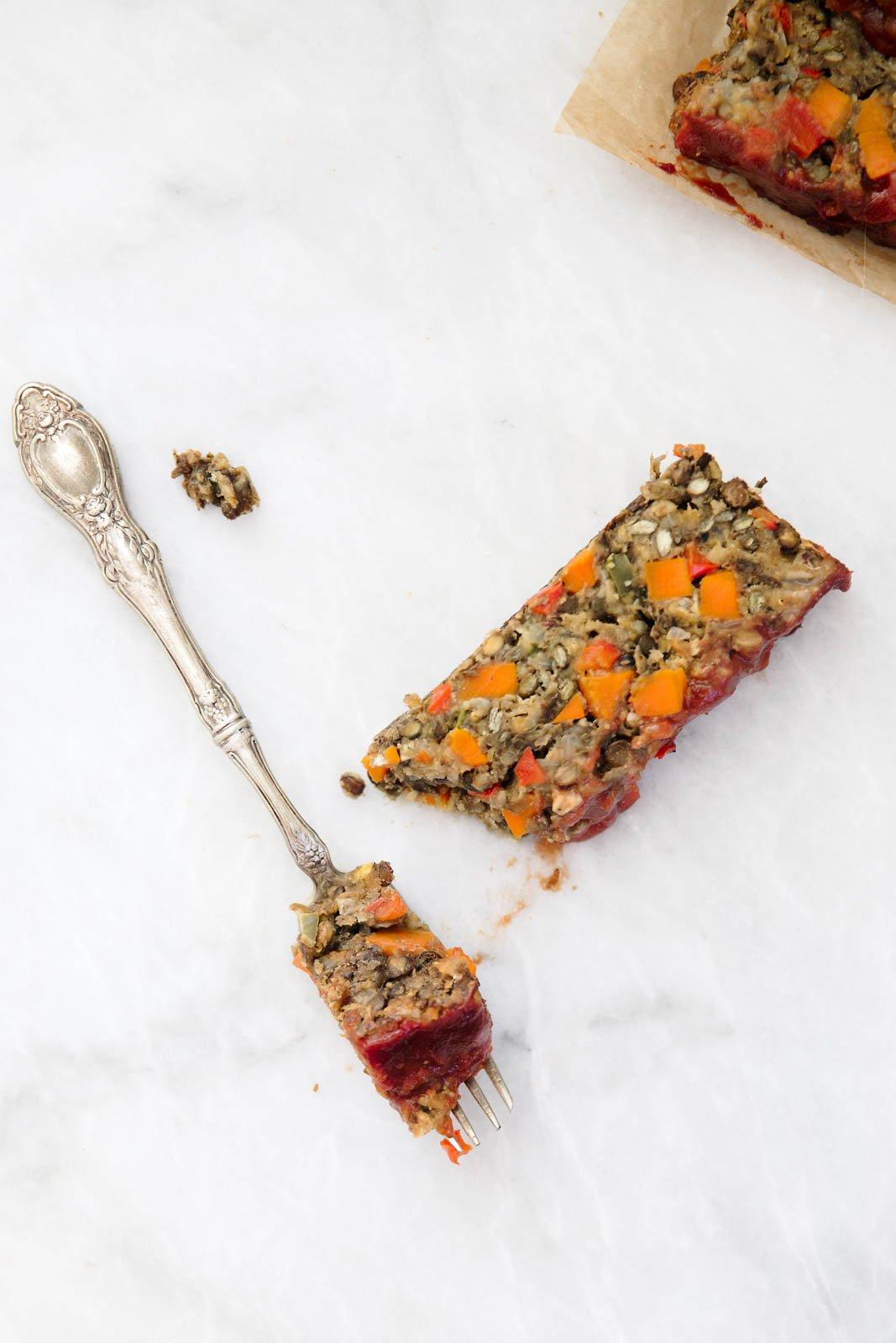 a slice of lentil loaf with a fork