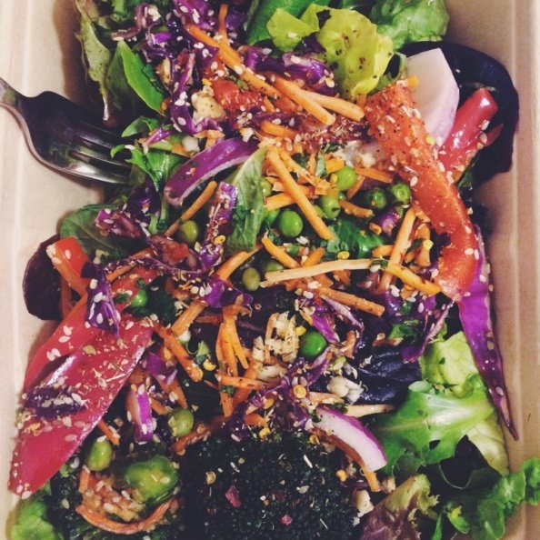 Rainbow salad in a cardboard container