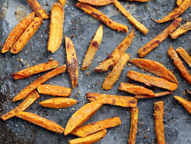 Baked sweet potato fries on a sheet pan