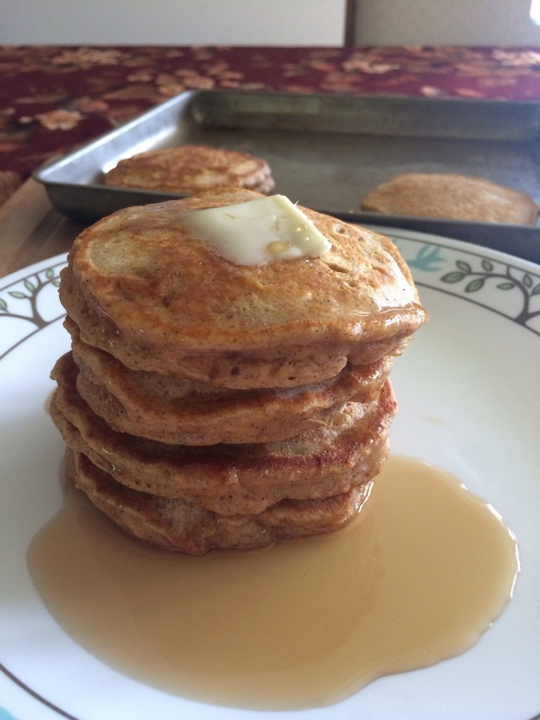 Stack of sweet potato pancakes on a plate