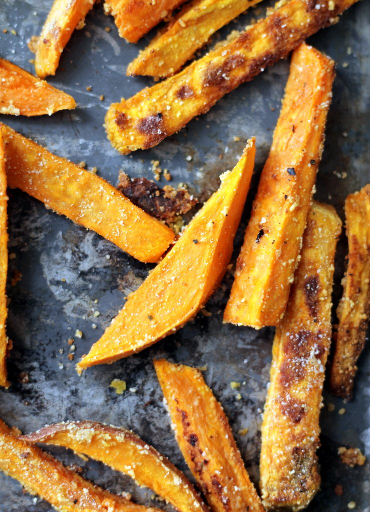 Healthy baked sweet potato fries on a sheet pan