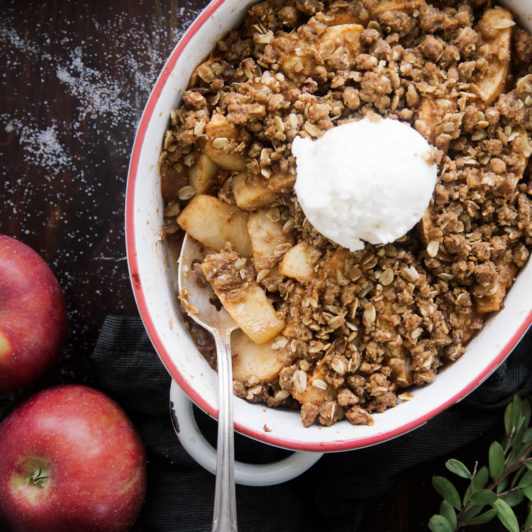 Healthy Apple Crisp in a casserole dish with a spoon