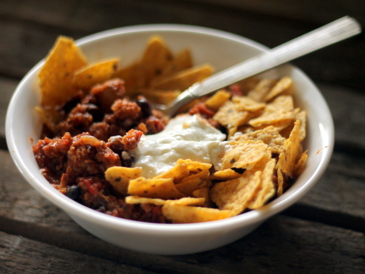 Healthy turkey quinoa chili in a bowl with tortilla chips