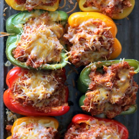 Sloppy joe stuffed bell peppers in a glass baking tray