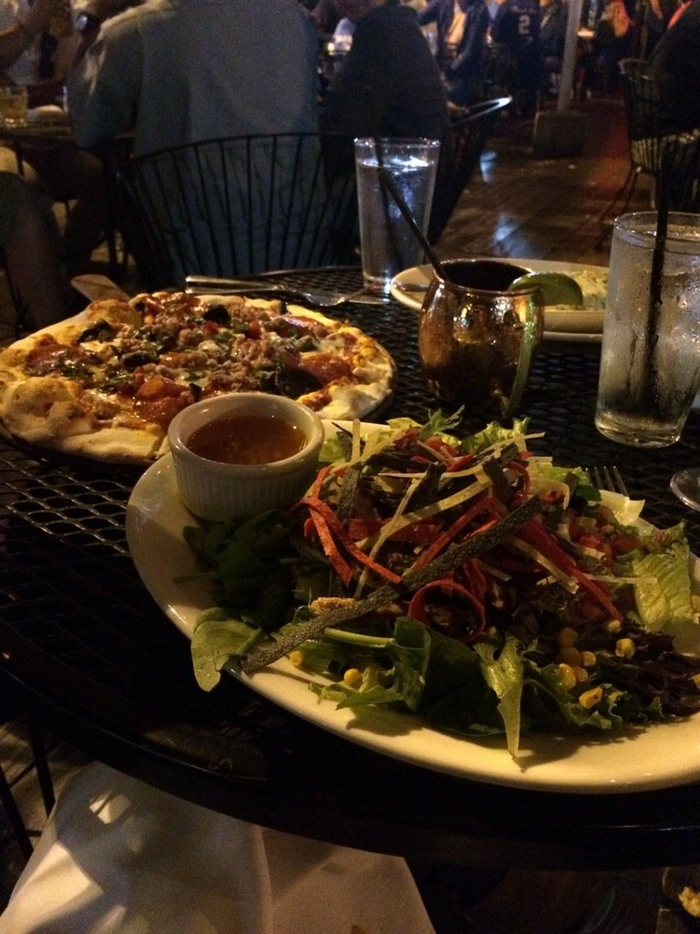 Salad and pizza on a table