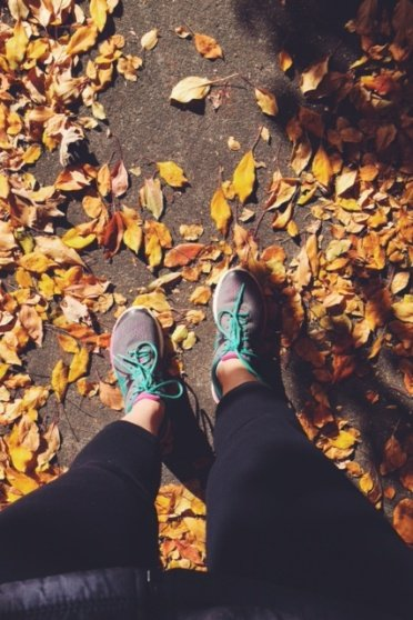 Standing on a path with fall leaves
