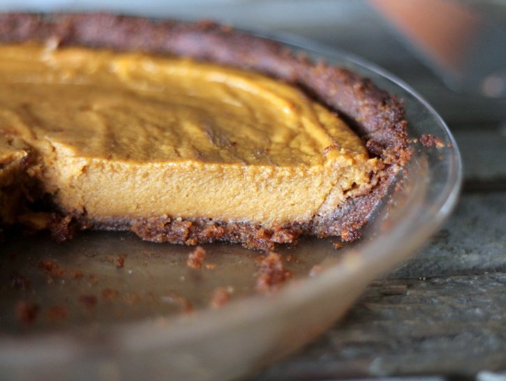 Sweet potato pie in a glass pie pan