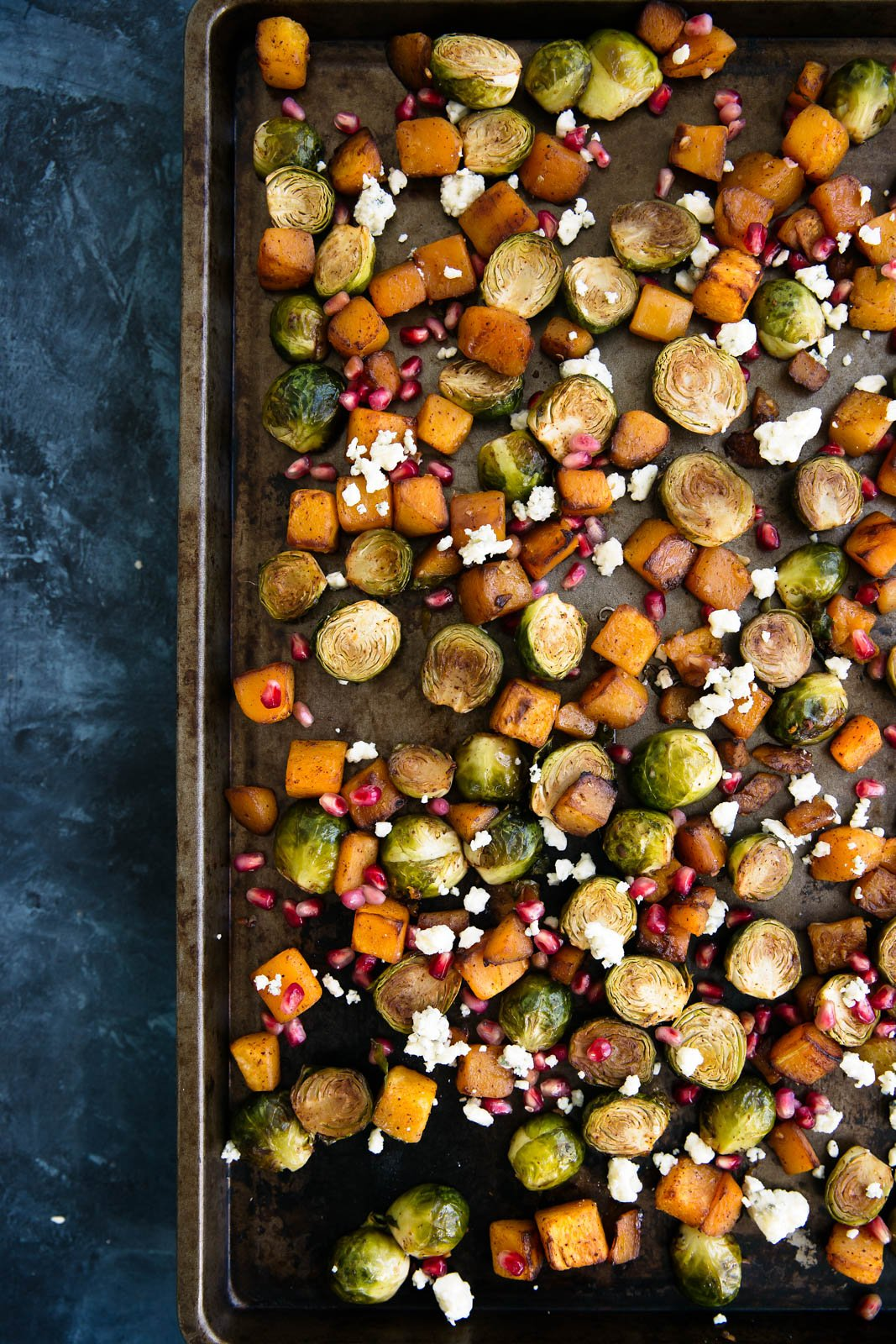 Delicious brussels sprouts and butternut squash tossed irresistible chili-maple sauce then roasted to perfection. Topped with sweet pomegranate seeds, zesty gorgonzola and crunchy pecans or walnuts if you'd like.