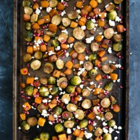 roasted butternut squash and brussels sprouts on a baking sheet