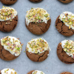 ginger cookies dipped in white chocolate sprinkled with pistachios