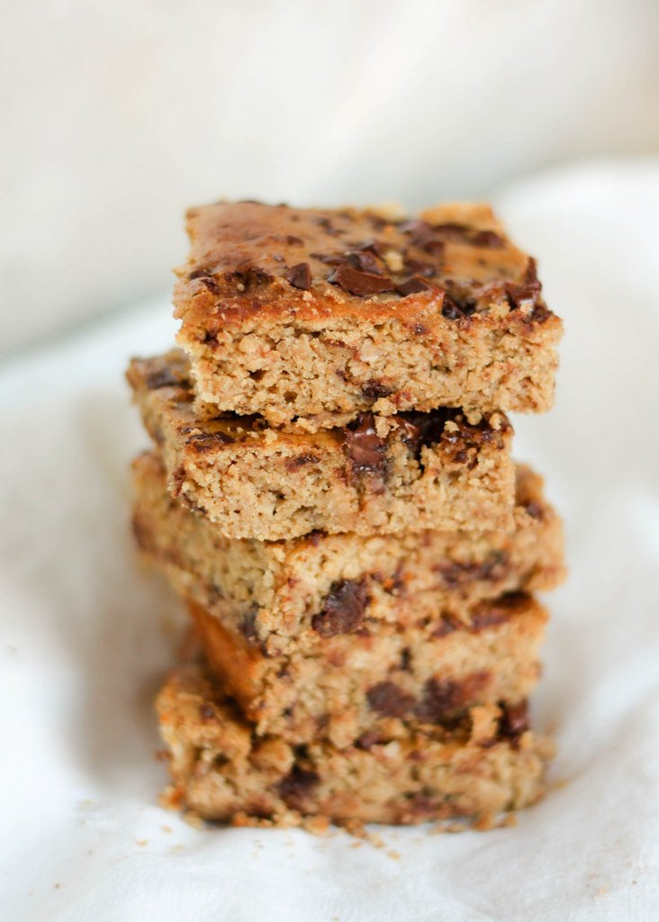 A chickpea blondie made with peanut butter, banana and protein powder. Each bite is full of delicious flavor and these are a great healthy treat. Grain free, gluten free, and dairy free!