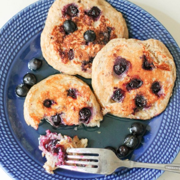Oatmeal yogurt pancakes with blueberries on a plate with a fork