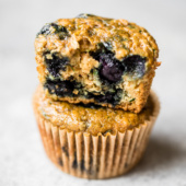 two healthy blueberry zucchini muffins in a stack
