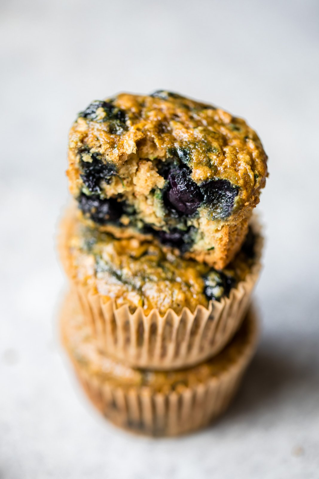 Healthy blueberry zucchini muffins made extra moist thanks to zucchini and applesauce! Naturally sweetened with pure maple syrup instead of sugar. Great for snacking & freezer-friendly too!