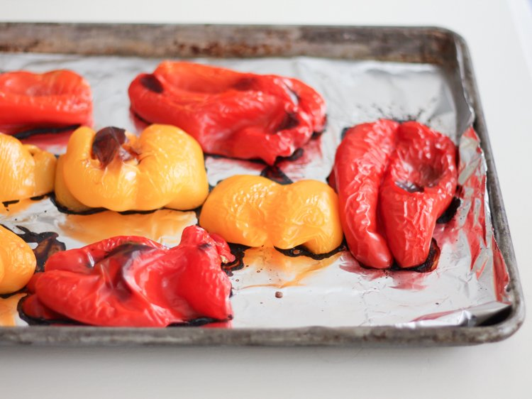 roasted bell peppers on a baking tray