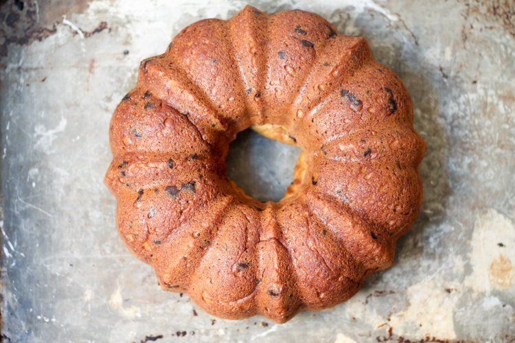 A lightened up banana bundt cake made with whole wheat flour, a touch of brown butter, honey and dark chocolate.