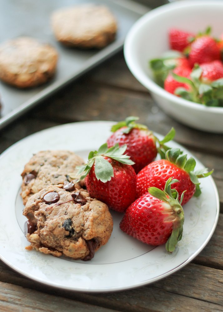 Chocolate chip oatmeal breakfast cookies on a plate with strawberries