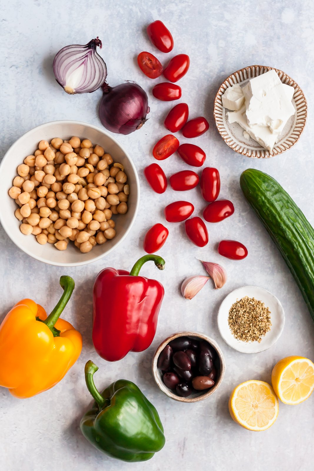 ingredients for greek chickpea salad on a grey surface