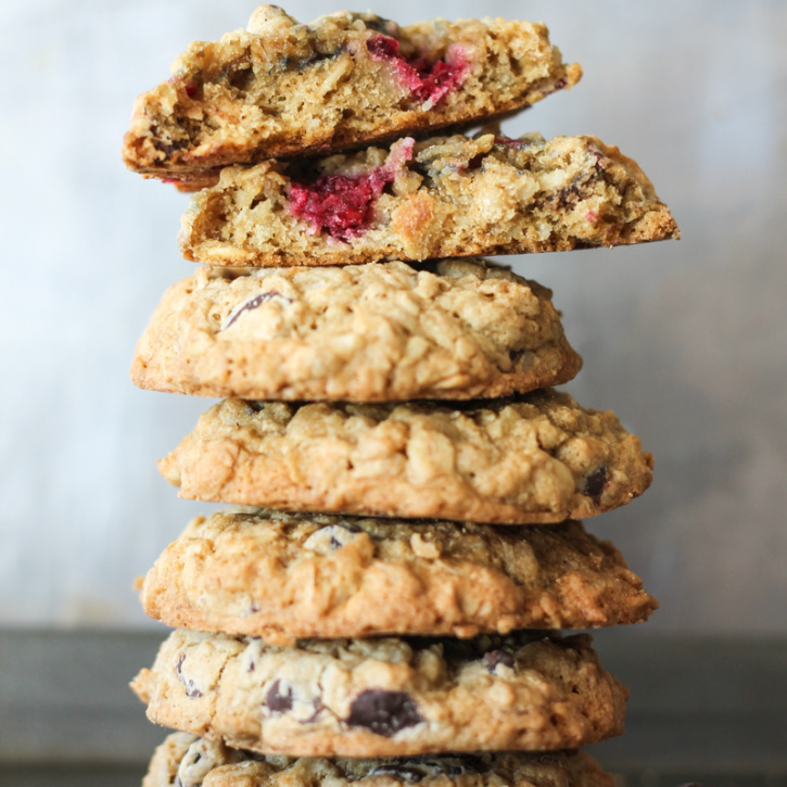 Chewy oatmeal cookies bursting with raspberries, dark chocolate and coconut! Made with coconut oil too!