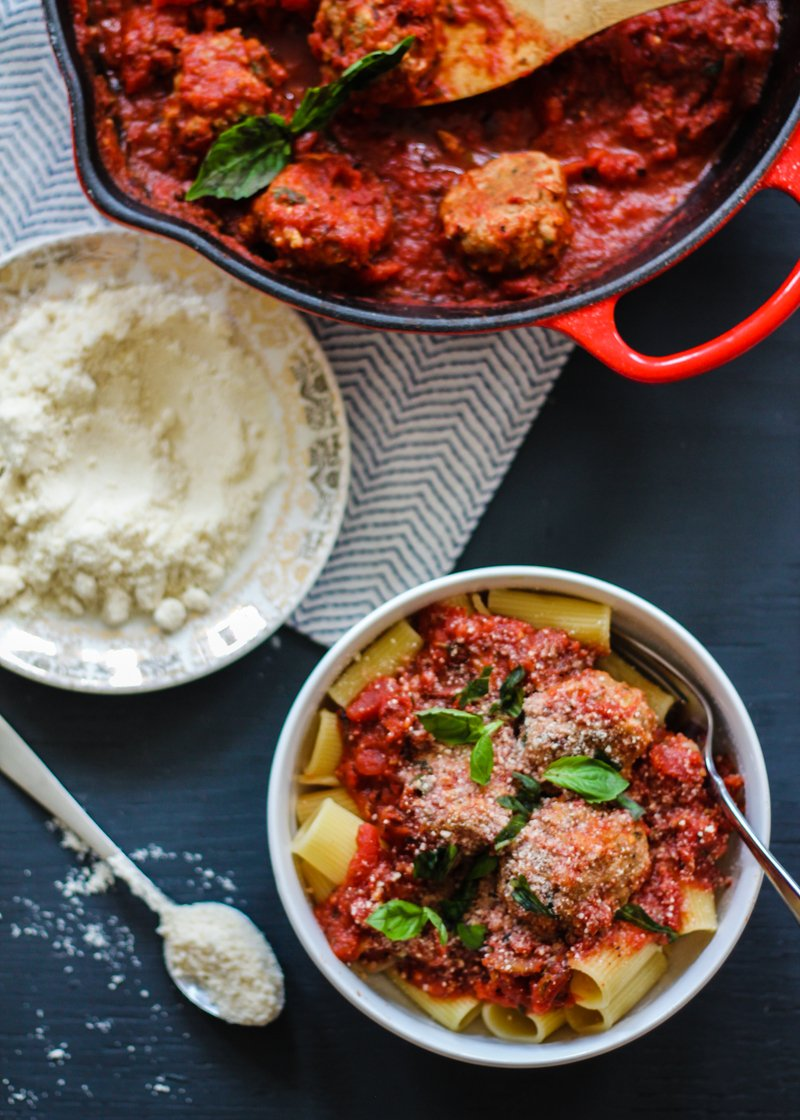 Turkey parmesan meatballs over rigatoni in a bowl