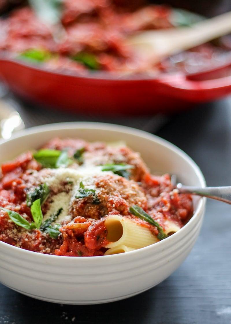 Turkey parmesan meatballs over rigatoni in a bowl