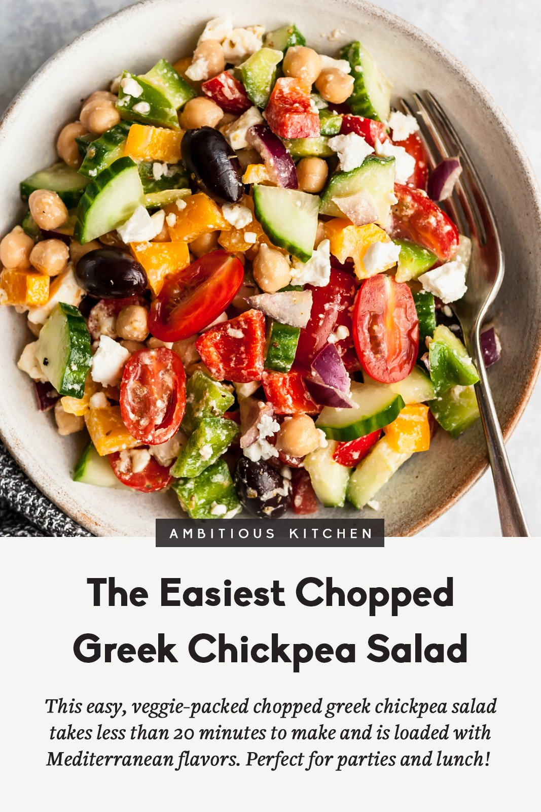 chopped greek chickpea salad in a bowl with a fork and a title underneath