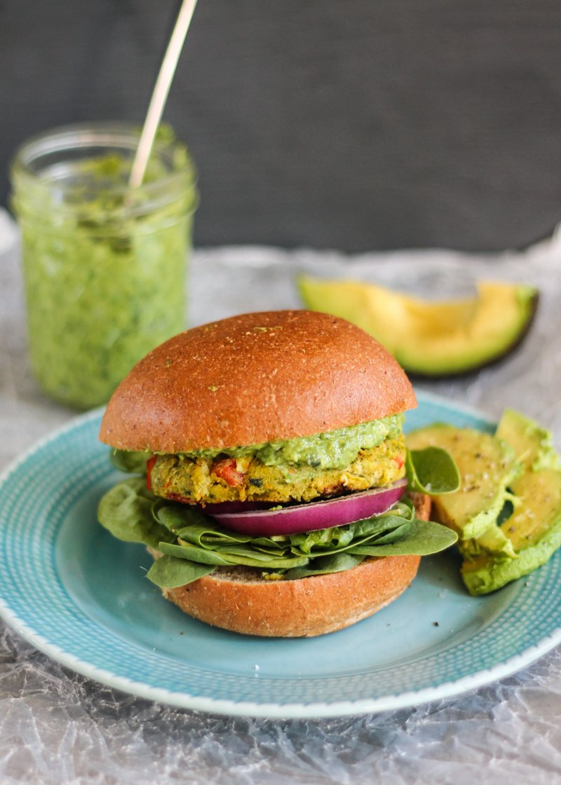 chickpea veggies burger on a plate with avocado