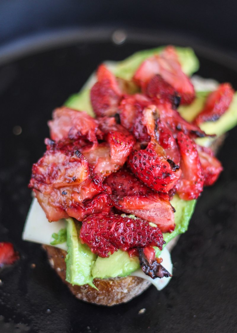 dairy free grilled cheese half with strawberries avocado in a pan